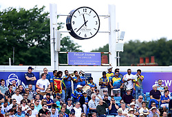 Sri Lanka fans play musical instruments underneath the Dickie Bird clock during the ICC Cricket World Cup group stage match at Headingley, Leeds.