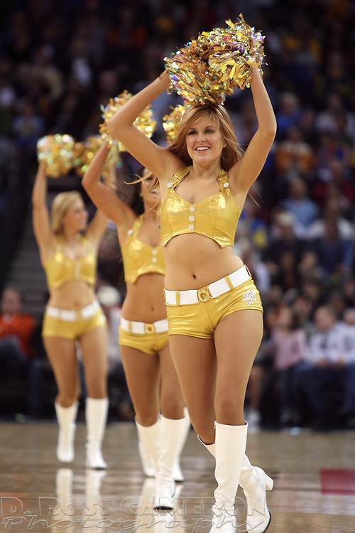 The Warrior Girls cheerleaders entertain the crowd during a timeout in an NBA basketball game between the Golden State Warriors and Indiana Pacers, Sunday, Jan. 13, 2008 in Oakland, Calif. (D. Ross Cameron/The Oakland Tribune)