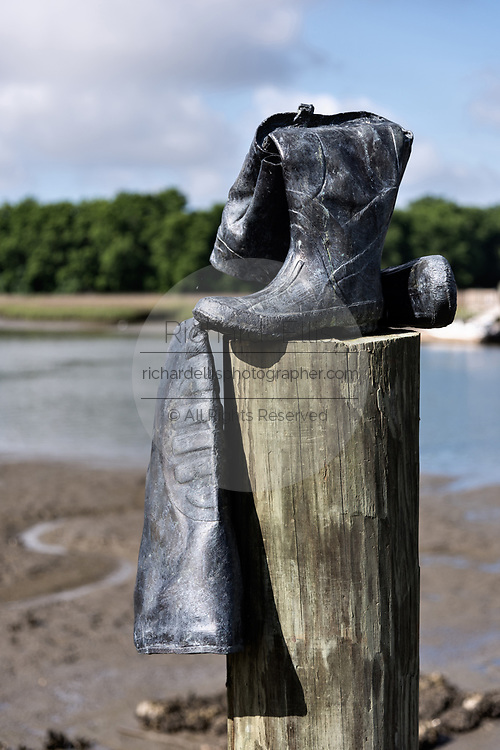 A sculpture of fisherman boats set on a piling as a memorial to Lowcountry Seaman erected along Jeremy Creek in the tiny hamlet of McClellanville, South Carolina. McClellanville is a tiny fishing village inside the Cape Romain National Wildlife Refuge and surrounded by Francis Marion National Forest.