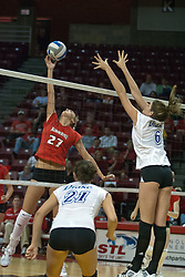 30 September 2006: Redbird freshman Katie Seyller strikes the ball towards Bulldogs Emily Madden (21) and Samantha Nelson. The Drake Bulldogs opened the match with a decisive win in the 1st game, but struggled in the next 3.  The Illinois State Redbirds took the match 3 games to 1.The match took place at Redbird Arena on the campus of Illinois State University in Normal Illinois.