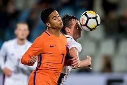 (L-R) Justin Kluivert of Jong Oranje, Emsis Eduards of Jong Letland during the EURO U21 2017 qualifying match between Netherlands U21 and Latvia U21 at the Vijverberg stadium on October 06, 2017 in Doetinchem, The Netherlands