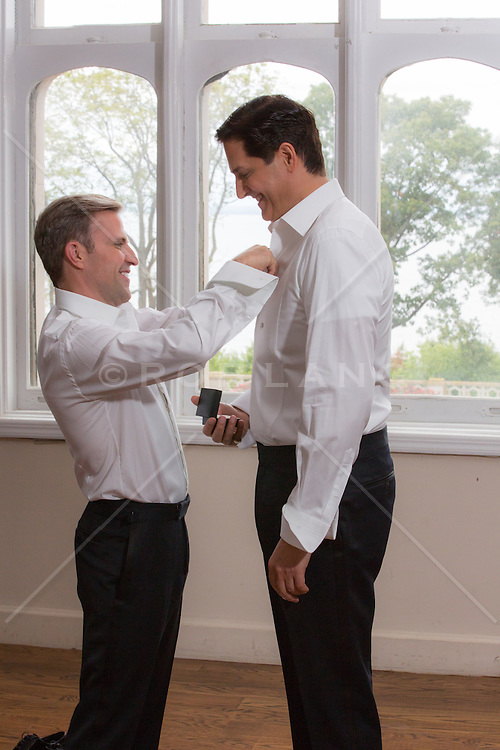 gay couple getting dressed on their wedding day
