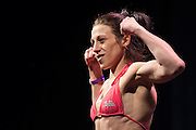 DALLAS, TX - MARCH 13:  Joanna Jedrzejczyk stands on the scale during the UFC 185 weigh-ins at the Kay Bailey Hutchison Convention Center on March 13, 2015 in Dallas, Texas. (Photo by Cooper Neill/Zuffa LLC/Zuffa LLC via Getty Images) *** Local Caption *** Joanna Jedrzejczyk