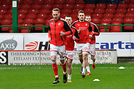 Chris Hussey (3) of Swindon Town and other players warming up before the EFL Sky Bet League 2 match between Swindon Town and Yeovil Town at the County Ground, Swindon, England on 10 April 2018. Picture by Graham Hunt.