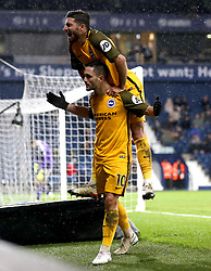 Brighton & Hove Albion's Florin Andone (bottom) celebrates scoring his side's first goal of the game with team mate Alireza Jahanbakhsh