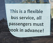 Sign for flexible bus service requiring advanced booking, Woodbridge, Suffolk, England, UK