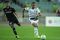 Tural Bayramov (27) of Qarabag FK fights for the ball with (?) of FC Basel  during the UEFA Europa Conference League group H match between Qarabag FK and FC Basel at  on September 16, 2021 in Baku, Azerbaijan.