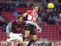 Photo. Glyn Thomas.<br /> Sunderland v Burnley. Nationwide Division 1.<br /> Stadium of Light, Sunderland. 29/11/03.<br /> Sunderland's George McCartney (R) fights an aerial battle for possession with Ian Moore.