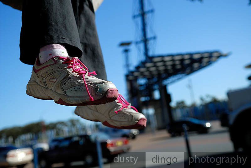 Chid's feet suspended in mid-air. Olympic Park, Sydney, Australia