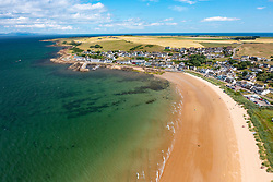 Aerial view from drone of Portmahomack village and beach, on Tarbat peninsula, Easter Ross, Scotland, UK