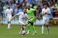 Leon Britton of Swansea city breaks away from Fernando of Manchester city.  Barclays Premier league match, Swansea city v Manchester city at the Liberty Stadium in Swansea, South Wales on Sunday 15th May 2016.<br /> pic by Andrew Orchard, Andrew Orchard sports photography.