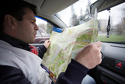 MSF driver, Aleksi, plans the MSF team's home visit appointments on a map of the town of Debaltsevo.