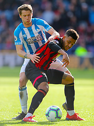 Huddersfield Town's Erik Durm (left) and Bournemouth's Joshua King battle for the ball during the Premier League match at the John Smith's Stadium, Huddersfield.