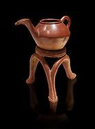Terra cotta Hittite beaker shaped side spouted teapot and three legged stand - 1700 BC to 1500BC - Kültepe Kanesh - Museum of Anatolian Civilisations, Ankara, Turkey. Against a black background .<br /> <br /> If you prefer to buy from our ALAMY STOCK LIBRARY page at https://www.alamy.com/portfolio/paul-williams-funkystock/hittite-art-antiquities.html  - Type Kultepe  into the LOWER SEARCH WITHIN GALLERY box. Refine search by adding background colour, place, museum etc<br /> <br /> Visit our HITTITE PHOTO COLLECTIONS for more photos to download or buy as wall art prints https://funkystock.photoshelter.com/gallery-collection/The-Hittites-Art-Artefacts-Antiquities-Historic-Sites-Pictures-Images-of/C0000NUBSMhSc3Oo