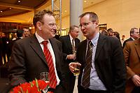 13 JAN 2003, BERLIN/GERMANY:<br /> Torsten Burmester (L), Persoenlicher Referent des Bundeskanzlers, und Albrecht Funk (R), Stellv. Leiter des Kanzlerbueros, im Gespraech, Neujahrsempfang der SPD Bundestagsfraktion, Fraktionsebene, Deutscher Bundestag<br /> IMAGE: 20030113-02-009<br /> KEYWORDS: Gespräch