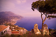 Buildings lie on a beautiful Italian cliffside, overlooking the sea