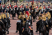 """The Household Cavalry, led by their mounted band, return to Buckinham Palace down the Mall - Trooping the Colour by the Irish Guards on the Queen's Birthday Parade. The Queen's Colour is """"Trooped"""" in front of Her Majesty The Queen and all the Royal Colonels.  His Royal Highness The Duke of Cambridge takes the Colonel's Review for the first time on Horse Guards Parade riding his horse Wellesley. The Irish Guards are led out by their famous wolfhound mascot Domhnall and more than one thousand Household Division soldiers perform their ceremonial duty. The Soldiers will parade in the traditional ceremonial uniforms of the Household Cavalry, Royal Horse Artillery, and Foot Guards. They are accompanied by the Household Division Bands & Corps of Drums. London 17th June 2017."""