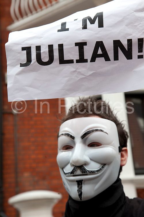"""London, UK. Thursday 16th August 2012. Supporters of Julian Assange from Anonymous UK wearing masks outside the Ecuador Embassy. These protesters were peaceful and were holding up signs saying """"I'm Julian""""."""