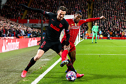 Georginio Wijnaldum of Liverpool challenges Saul Niguez of Atletico Madrid - Mandatory by-line: Robbie Stephenson/JMP - 11/03/2020 - FOOTBALL - Anfield - Liverpool, England - Liverpool v Atletico Madrid - UEFA Champions League Round of 16, 2nd Leg