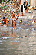 Holy man bathing in the Ganges river in Varanasi, Uttar Pradesh, India