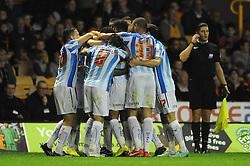 Huddersfield Town's Sean Scannell celebrates with his team mates after scoring. - Photo mandatory by-line: Dougie Allward/JMP - Mobile: 07966 386802 - 01/10/2014 - SPORT - Football - Wolverhampton - Molineux Stadium - Wolverhampton Wonderers v Huddersfield Town - Sky Bet Championship