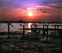 SUNSET OVER BOSHAM HARBOUR, WEST SUSSEX, ENGLAND. PHOTO BY TERRY FINCHER