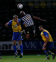 Photo: Steve Bond.<br />Notts County v Hereford United. Coca Cola League 2. 02/10/2007. Jason Lee (C) outjumps Trent McClenahan