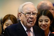 Berkshire Hathaway CEO Warren Buffett licks his lips after enjoying an ice cream treat from Dairy Queen before the Berkshire Hathaway annual meeting in Omaha, Nebraska, U.S. May 6, 2017. REUTERS/Rick Wilking
