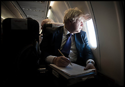 London Mayor Boris Johnson writing his speech on a flight from Delhi to Hyderabad, on the Third day of a six-day tour of India, where he will be trying to persuade Indian businesses to invest in London, Tuesday November 27, 2012. Photo by Andrew Parsons / i-Images
