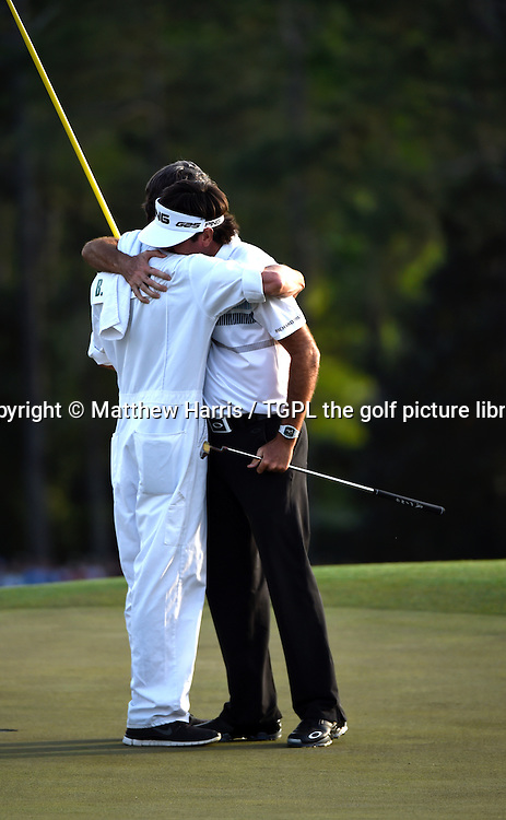 Bubba WATSON (USA) celebrates with his caddie Ted Scott after winning his second Masters title during fourth round US Masters 2014,Augusta National,Augusta, Georgia,USA.
