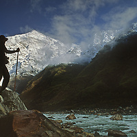 Mountaineer David Breashears looks up at Mount Gyala Pheri towering over the Tsangpo River Gorge, one of the world's deepest canyons, in remote southeastern Tibet, China.