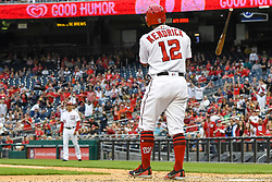 May 6, 2018 - Washington, DC, U.S. - WASHINGTON, DC - MAY 06:  Washington Nationals first baseman Howie Kendrick (12) tosses his bat after being hit by a pitch in the ninth inning during the game between the Philadelphia Phillies  and the Washington Nationals on May 6, 2018, at Nationals Park, in Washington D.C.  The Washington Nationals defeated the Philadelphia Phillies, 5-4.  (Photo by Mark Goldman/Icon Sportswire) (Credit Image: © Mark Goldman/Icon SMI via ZUMA Press)