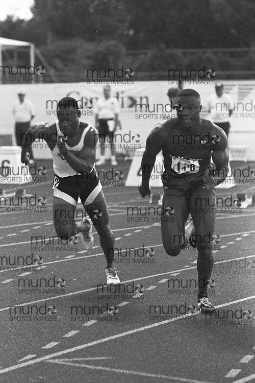 (Montreal, Canada --- 25 July 1991) Ricardo Greenidge (L) and Atlee Mahorn (R) in the 100m heats at the 1991 Canadian National Track and Field Championships held at the Complexe sportif Claude-Robillard in Montreal. Photo 1991 Copyright Sean Burges / Mundo Sport Images. ******This is an unprocessed scan from the negative. You can buy it as is and clean it up yourself, or contact us for rates on providing the service for you. *******