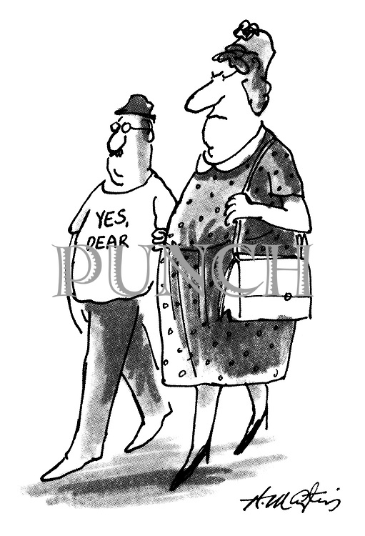 Yes, Dear. (a small man wearing a Yes Dear t-shirt while accompanying his domineering wife)