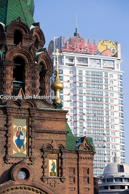 Detail of Saint Sophia Church and modern high rise apartment building in Harbin China 2009