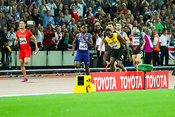 London, August 12 2017 . Usain Bolt, anchor for Jamaica, pulls up in the anchor leg with a hamstring injury in the men's 4x 100m relay on day nine of the IAAF London 2017 world Championships at the London Stadium. © Paul Davey.