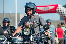 Licenced Harley-Davidson artist Scott Jacobs riding his 1926 Harley-Davidson JD over the finish line at the end of Stage 16 (142 miles) of the Motorcycle Cannonball Cross-Country Endurance Run, which on this day ran from Yakima to Tacoma, WA, USA. Sunday, September 21, 2014.  Photography ©2014 Michael Lichter.