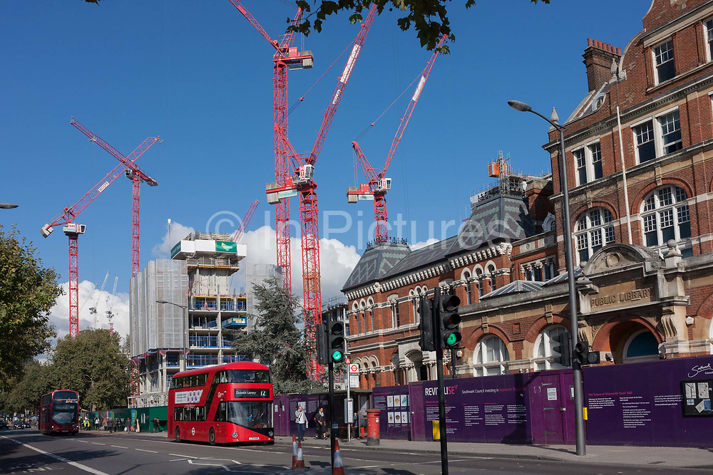 A London bus passes the new Elephant Park development on the Walworth Road, Elephant & Castle, on 11th October 2016, in London, England. Southwark Council's development partner, Lendlease is regenerating over 28 acres across three sites at the heart of Elephant & Castle, in what is the latest major regeneration opportunity in zone 1 London. The vision for the £1.5 billion regeneration is to build on the area's strengths and vibrant character in order to re-establish Elephant & Castle as one of London's most flourishing urban quarters. The Elephant & Castle regeneration is of a scale rarely seen in central London and includes almost 3,000 new homes, plus office, retail, community, leisure and restaurant space.