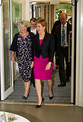 Pictured: Nicola Sturgeon and Diana Noel-Paton, Chief Executive of the foundation<br /> <br /> The First Minister Nicola Sturgeon, MSP, joined people supported by the Thistle Foundation to bury a time capsule to mark the opening of a new health and social care centre. <br /> Ger Harley | EEm 14 June 2016
