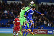 Cardiff city goalkeeper David Marshall punches clear from Balint Bajner of Ipswich. Skybet football league championship match, Cardiff city v Ipswich Town at the Cardiff city stadium in Cardiff, South Wales on Tuesday 21st October 2014<br /> pic by Andrew Orchard, Andrew Orchard sports photography.