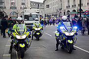 Motorcycle police at the Britain is Broken - General Election Now demonstration against Tory cuts and austerity on 12th January 2019 in London, United Kingdom. Irrespective of which way people voted in the EU referendum, this protest was calling for an end to austerity and homelessness, the nationalisation of rail and other utilities, and ultimately, for a general election to end the Tories power.