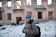 Lucine- on her way from school is walking by destroyed building  in Shushi- virtually abandoned town after the war between Armenia and Azerbaijan over  Nagorno Karabakh...Both Armenian and Azeri consider the town of the mayor historical importance to their nation. It is called Shushi by Armenians and  Shusha by Azerbaijanis.Before the war majority of inhabitants were Azeri-now none of them is left...In May 2003, the French department of the Armenian charity Chêne announced that it would take charge of the renovation of the Persian mosque of Shushi, dated from the 18th century...