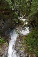 Cascade Creek below the Cascade Falls suspension bridge in Cascade Falls Regional Park near Mission, British Columbia, Canada