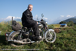 Denver Joe Hicks poses with a spectacular background of 23,000' peaks on day-4 our our Himalayan Heroes adventure riding from Pokhara to Kalopani, Nepal. Friday, November 9, 2018. Photography ©2018 Michael Lichter.
