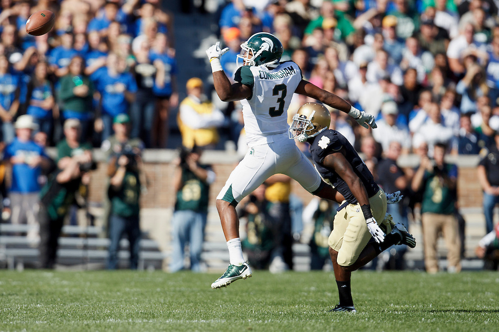 Michigan State wide receiver B.J. Cunningham (#3) makes leaping attempt of pass reception in action during NCAA football game between Notre Dame and Michigan State.  The Notre Dame Fighting Irish defeated the Michigan State Spartans 31-13 in game at Notre Dame Stadium in South Bend, Indiana.