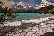 Wind whips up water on Lage Pehoe, Cuernos el Paine above, Parque Nacional Torres del Paine, Patagonia, Chile.