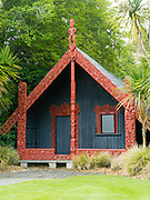 View and detail of the wharepuni (Maori meeting house) in the rear of Anderson Park, Invercargill, New Zealand