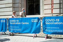 © Licensed to London News Pictures. 08/06/2021. LONDON, UK.  People arrive at an NHS vaccination centre at the Science Museum in South Kensington.  The UK government has announced that over 25s can now receive the coronavirus vaccine. Concerns about the impact of the so-called Indian variant on full relaxation of lockdown restrictions on June 21 continue.  Photo credit: Stephen Chung/LNP