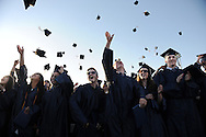 Needham High School graduates toss their caps in celebration, Monday, June 6, 2016.<br /> Wicked Local staff photo / Kate Flock