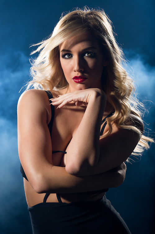 Portrait of sensual blonde woman looking at camera  in a night dress